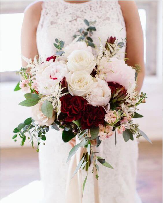 Bride with burgundy and blush bouquets for burgundy and blush wedding