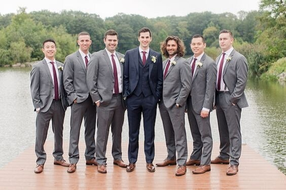 Grey groomsmen suit with burgundy tie for burgundy and blush wedding
