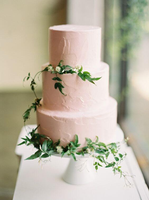 White wedding cake with greenery for blush and green wedding