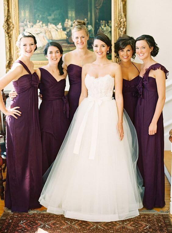 White bride and plum bridesmaids for Plum Fall wedding
