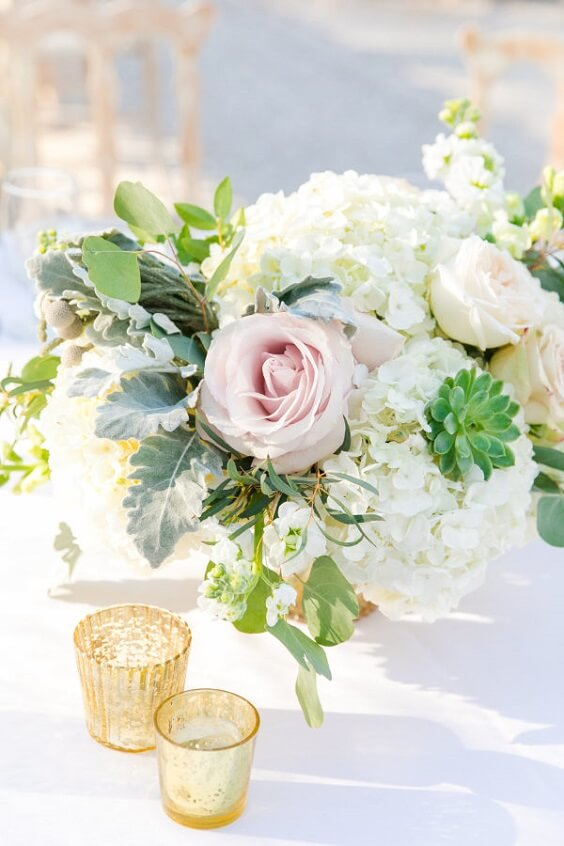 Table centerpieces for royal blue and pink winter wedding