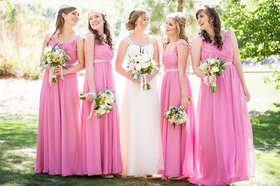 Pink bridesmaid dresses for pink and greenery March wedding