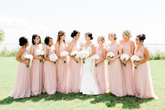 Blush bridesmaid dresses for blush and white March wedding