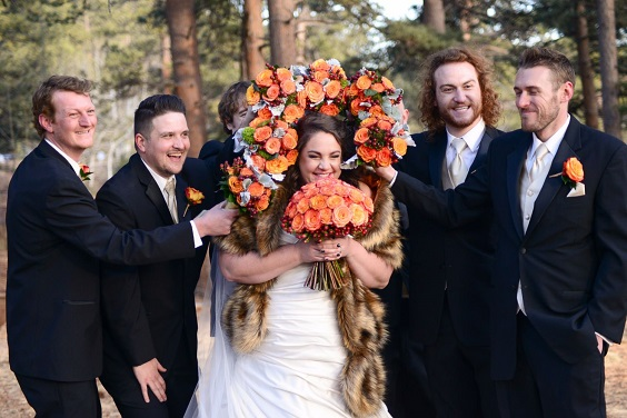 white bridal gown tangerine bouquets for february wedding colors 2022 black tangerine and brown colors