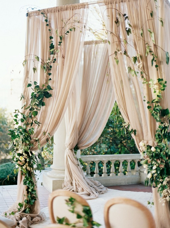 champagne wedding arch with greenery for march wedding colors 2022 champagne