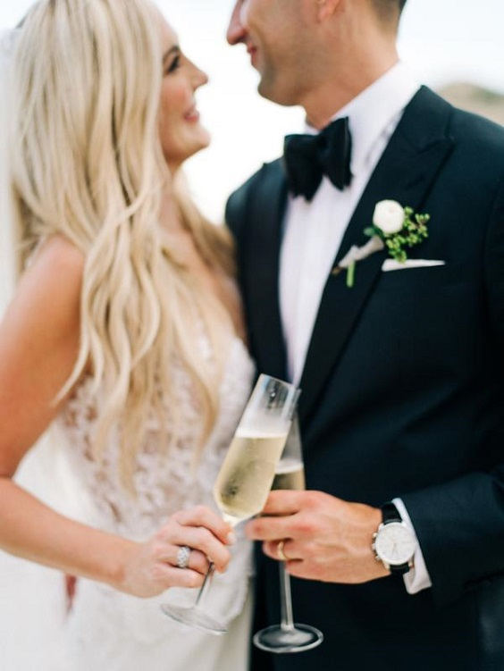 white bridal gown and black mens suit for march wedding colors 2022 champagne