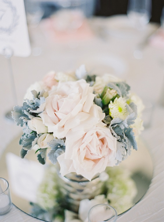 blush and dusty blue centerpieces for march wedding colors 2022 dusty blue white and blush