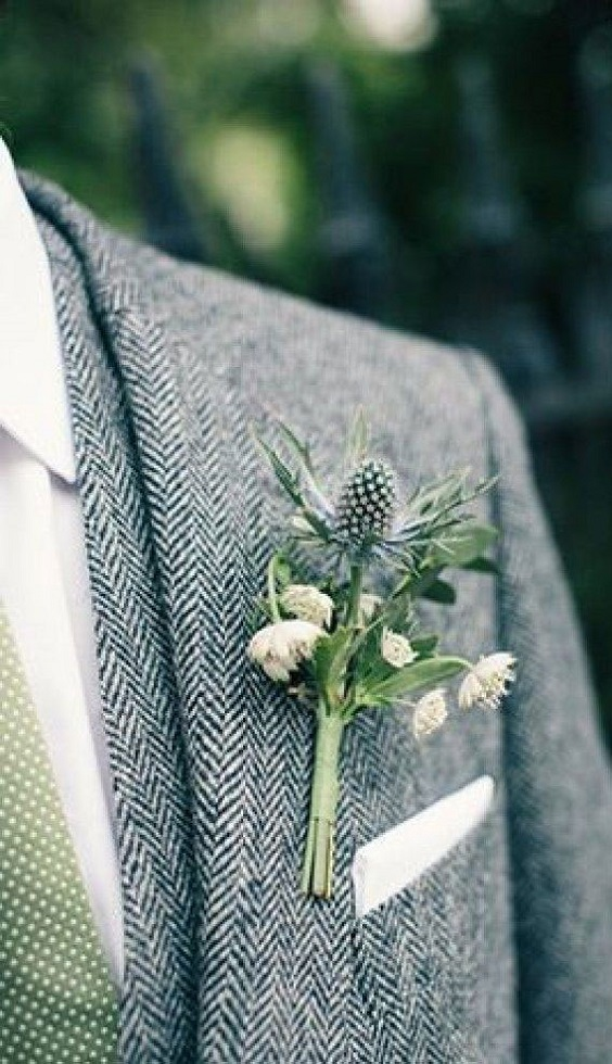 grey mens suit and green boutonniere for march wedding colors 2022 grey and greenery