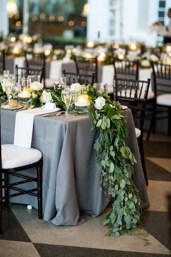 grey tablecloth and greenery centerpieces for march wedding colors 2022 grey and greenery