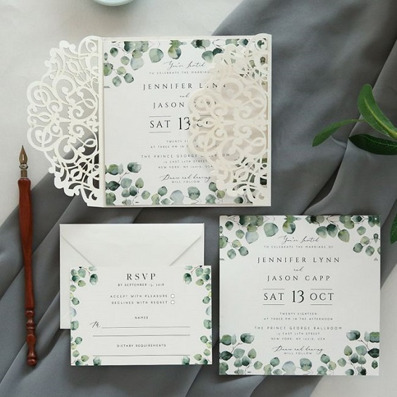white invitation with green accent for march wedding colors 2022 grey and greenery