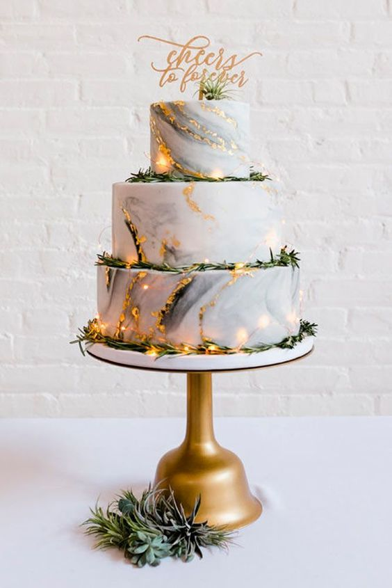 wedding cake with golden accent for march wedding colors 2022 ivory and gold