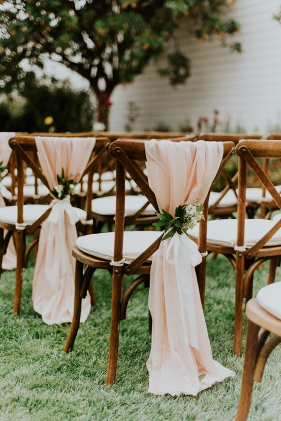 chairs with blush draped fabric for march wedding colors 2022 sage green and blush
