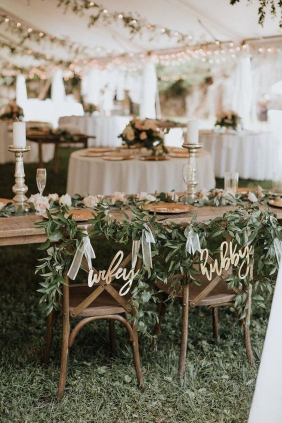 head chairs with greenery for march wedding colors 2022 sage green and blush