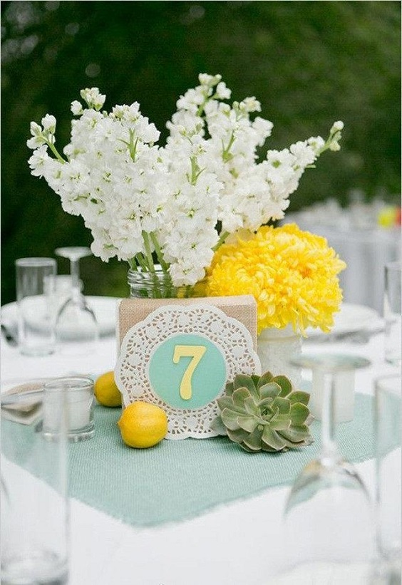 mint wedding table card with yellow and white flower decorations for April wedding colors 2022 mint yellow and white