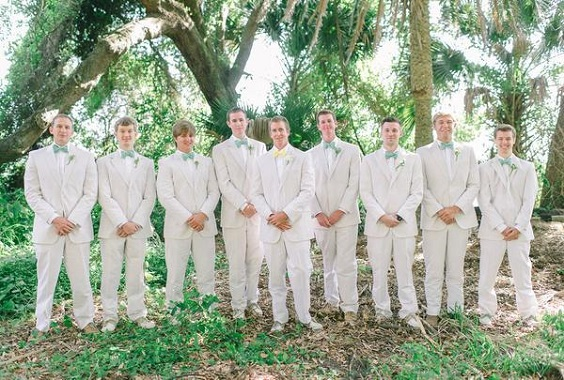 white men's suits with mint and yellow ties for April wedding colors 2022 mint yellow and white