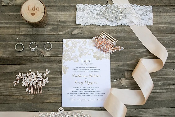 wedding invitation decorated with champagne ribbons for April wedding colors 2022 dusty rose champagne rose gold