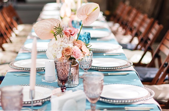 light blue wedding tablecloth peach flower centerpieces for April wedding colors 2022 light blue blush and peach colors