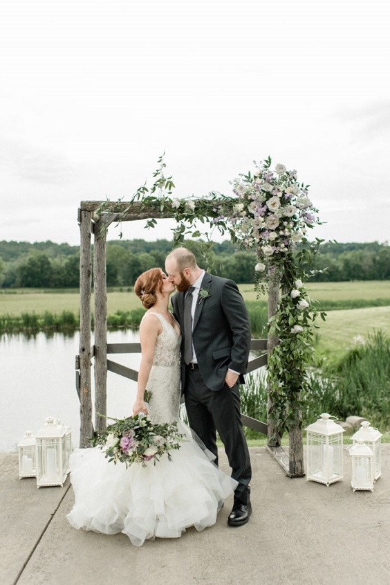 lavender and greenery floral on wedding arch and bouquets for April wedding colors 2022 light pink pale yellow and gold colors