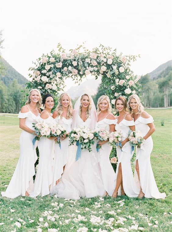 white bridal gown and white bridesmaid dresses for April wedding colors 2022 white and blue colors