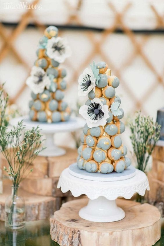 croquembouche towers with splashes of dusty blue for june wedding colors 2022 dusty blue and yellow