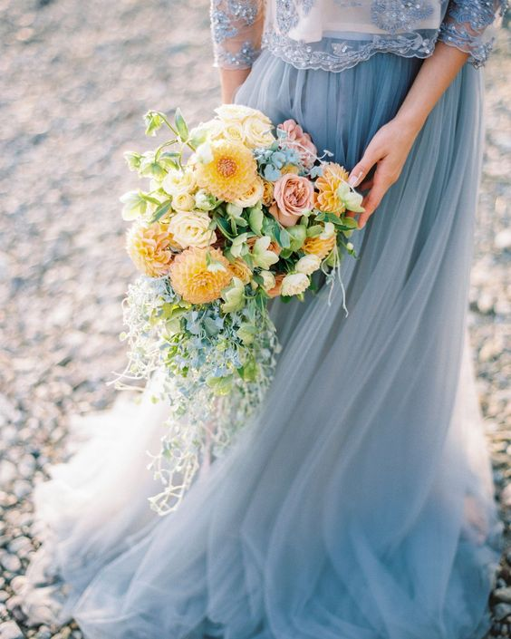 dusty blue dress and yellow bouquet for june wedding colors 2022 dusty blue and yellow