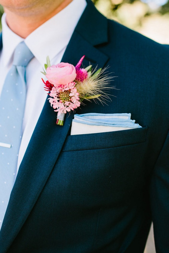 black mens suit with ice blue tie and fuschia pink boutonniere for june wedding colors 2022 ice blue and fuschia