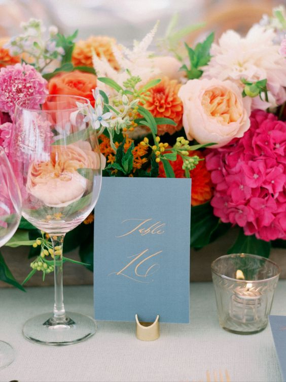 fuschia centerpieces and ice blue table card for june wedding colors 2022 ice blue and fuschia