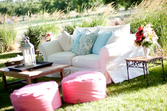 sofa and ice blue pillows for june wedding colors 2022 ice blue and fuschia