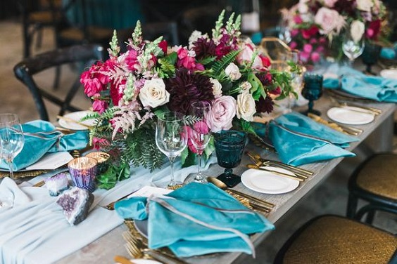 raspberry centerpieces and blue napkins for june wedding colors 2022 raspberry and blue