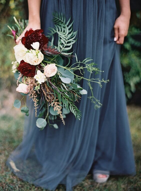 burgundy bouquet and blue bridesmaid dresses for fall wedding colors 2022 dusty blue and burgundy