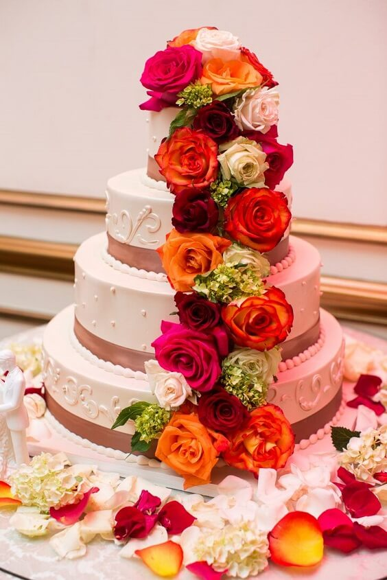 b1599 wedding cake with colorful roses for fall wedding colors 2022 purple and yellow
