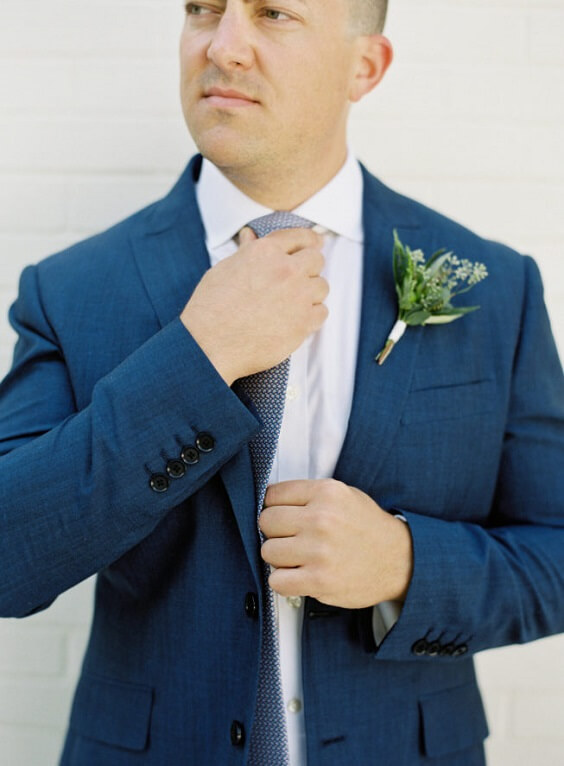 green boutonniere and blue men suit for fall wedding colors 2022 green and grey