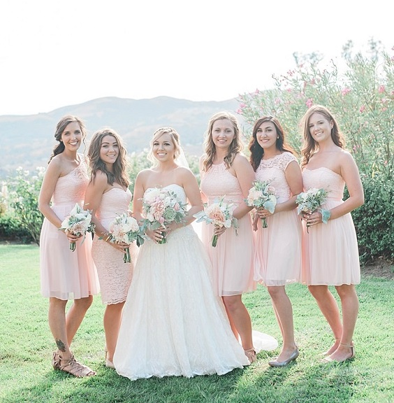 blush bridesmaid dresses and white bridal gown for summer wedding color 2022 blush and sage