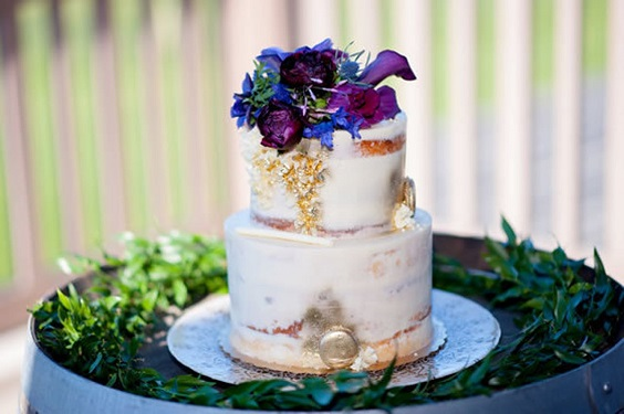 wedding cake dotted with purple flowers for summer wedding color 2022 purple and khaki colors