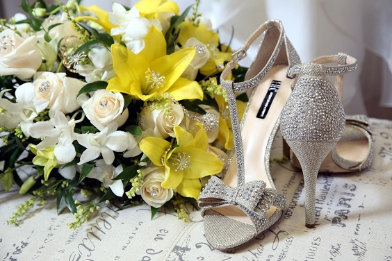 yellow and white bouquets silver wedding shoes for summer wedding color 2022 yellow and silver colors