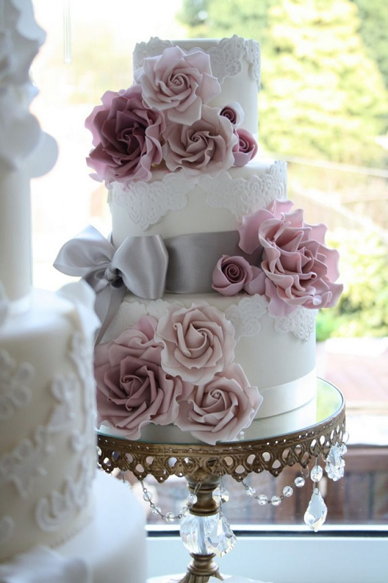 white wedding cake with mauve flowers and grey ribbons for summer wedding color 2022 mauve and grey colors
