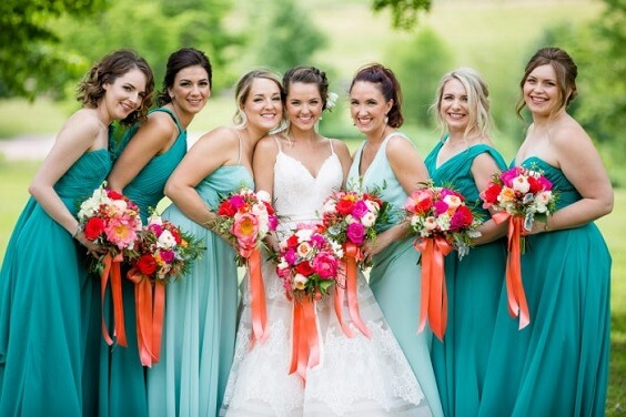 teal bridesmaid dresses and bouquets with orange ribbon for fall wedding colors for 2022 teal and orange