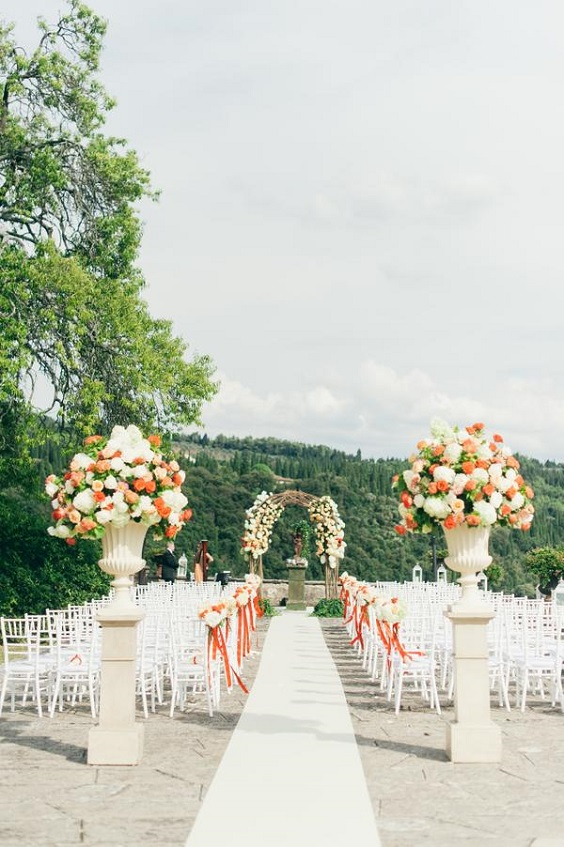 wedding aisle for spring wedding colors 2022 coral peach sage colors