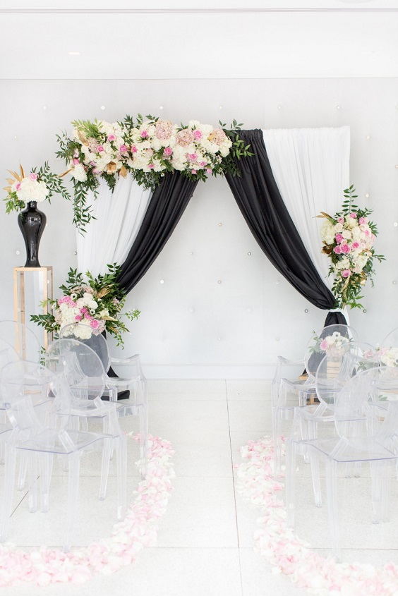 wedding arch with black cloth pink and white flower decoration for spring wedding colors 2022 black white pink colors