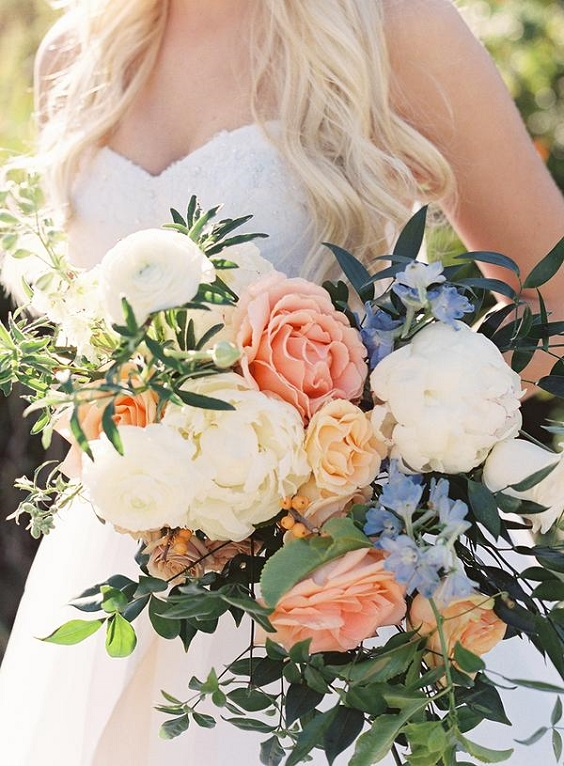 bridal bouqets with peach dusty blue-white flowers for spring wedding colors 2022 dusty blue peach greenery