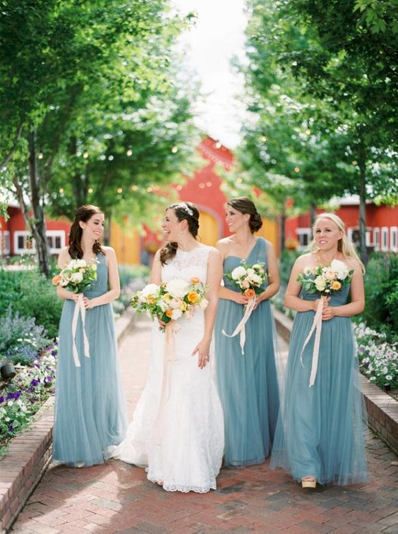 dusty blue bridesmaid dresses for spring wedding colors 2022 dusty blue peach greenery
