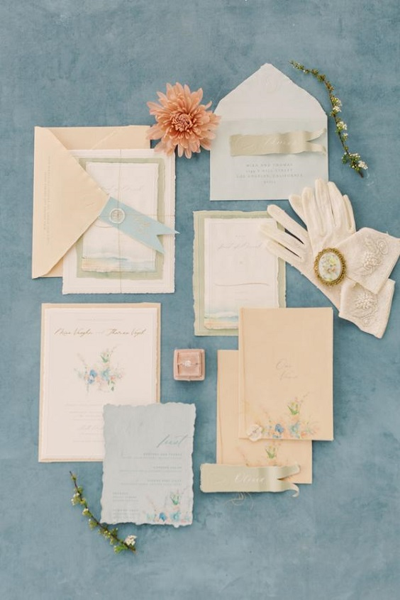 wedding invites with peach dusty blue covers for spring wedding colors 2022 dusty blue peach greenery