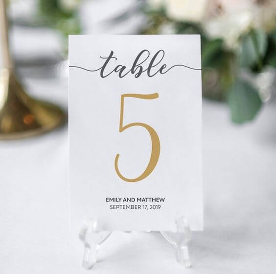 Table numbers for Navy blue and Champagne Winter wedding