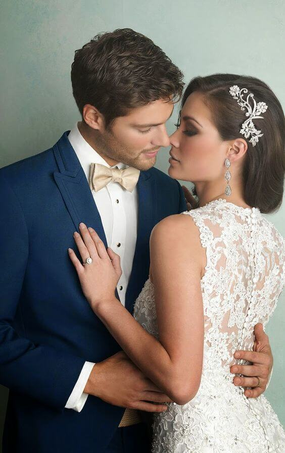 White bridal gown and navy groom for Navy blue and Champagne Winter wedding