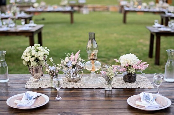 Table decorations for Blush and dusty blue wedding