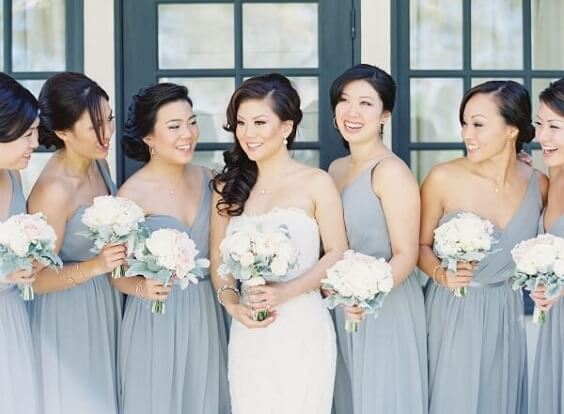 White bride and dusty blue bridesmaids for Blush and dusty blue wedding