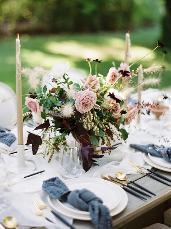 Table decorations for dusty rose and dusty blue wedding