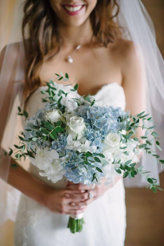 Wedding Bouquets for dusty blue March wedding