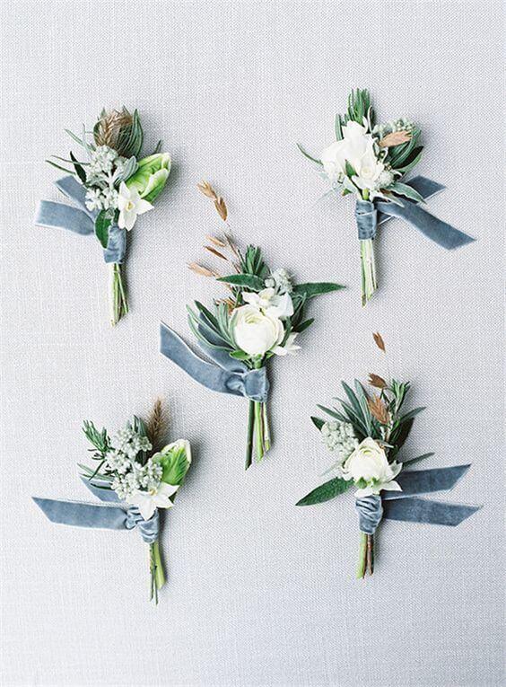 Wedding boutonniere for dusty blue March wedding