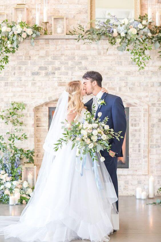 White Bride and Navy groom for dusty blue March wedding